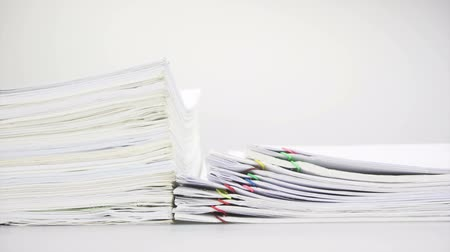 квитанция : Paper report sales and receipt with step overload of old paperwork place on table time lapse. Pile of document is increasing with paperclip as work is going to be successful. Business concept footage. Стоковые видеозаписи