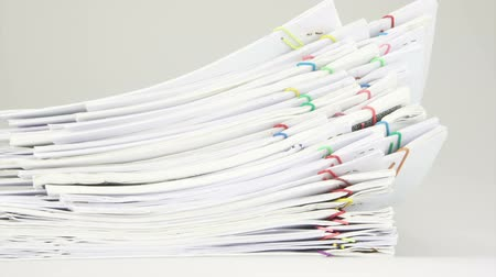 Pile of paper of report and paperwork place on table with white background time lapse. Pile of document was organize with paperclip as work is going to be successful. Business concept footage. Stok Video
