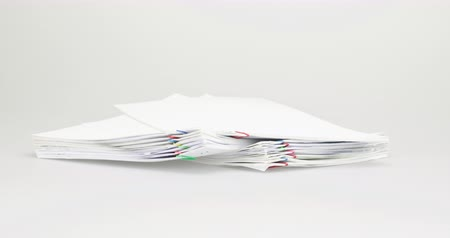 Pile of receipt overload with colorful paperclip place on table with white background time lapse. Pile document is increasing with paperclip as work is going to be success. Business concept footage. Stok Video
