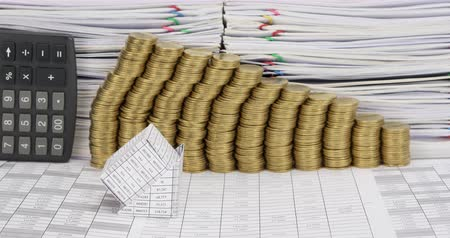 Bankruptcy of house have step pile of gold coins and calculator place vertical on finance account with pile of overload paperwork time lapse. Business is going bankrupt. Business concept footage.