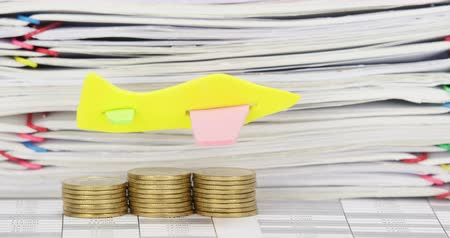 Airplane fly on step pile of gold coins increasing have stack overload document of receipt and report with colorful paperclip as background time lapse. Business concept footage. Stok Video