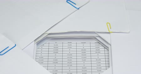 Pile overload document of report with colorful paperclip place on finance account time lapse. Pile of document is increasing with paperclip as work is going to be successful. Business concept footage. Dostupné videozáznamy