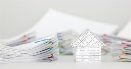 House have blur pile overload paperwork of receipt and report with colorful paperclip place on white background time lapse. Pile of document is increasing as work successful. Business concept footage. Dostupné videozáznamy