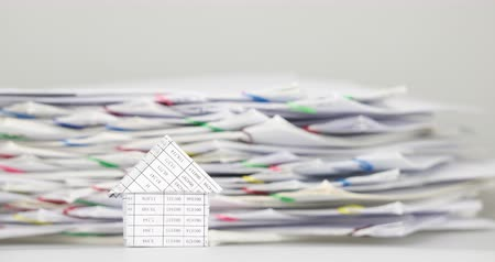 House have blur pile overload confuse document of receipt and report with colorful paperclip are decreasing place on white background time lapse. Business concept successful footage.