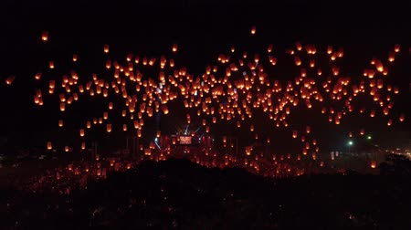 crowded : Drone tilt up sky lantern thousand lanterns 4k 60fps Stock Footage