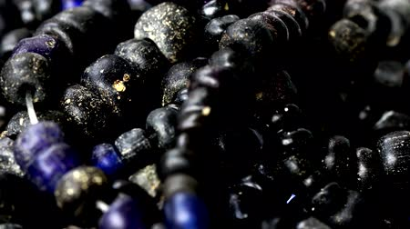 pingente : Close up of Ancient rare black Tradewind glass Beads