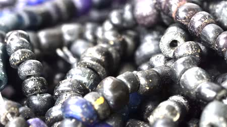 ожерелье : Close up of Ancient rare black Tradewind glass Beads
