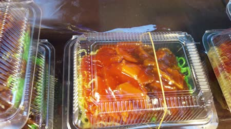kluski : egg noodle soup with BBQ pork in Take away plastic box at night street food market