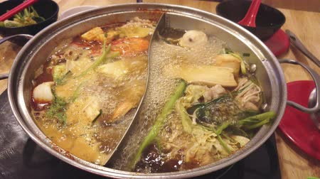 kluski : Shabu shabu or sukiyaki japanese style food, Half pot hot boiling and vegetable and pork