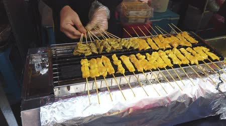daldırma : Grilled pork satay on stove street food in phuket town, popular street food in Thailand