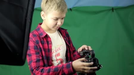 technics : A teenager video blogger includes a video camera.