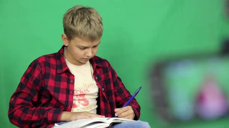 technics : The boy video blogger writes a script for the plot. Stock Footage