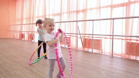 Little girls with sports hoops. Stok Video