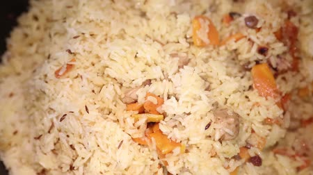 Preparation of rice dishes - pilaf from Uzbekistan.
