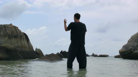 taiji : Handsome Man Practicing Tai Chi at the Sea Stock Footage