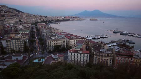 neapol : A panning clip cityscape of Naples, from an high point of view, at the sunset hour