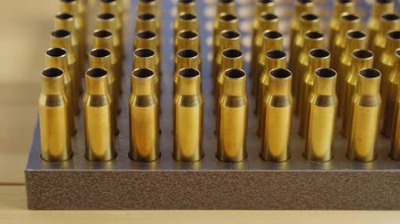 구경 : Production of cartridges for a rifle, reload. Many empty shells in the stand
