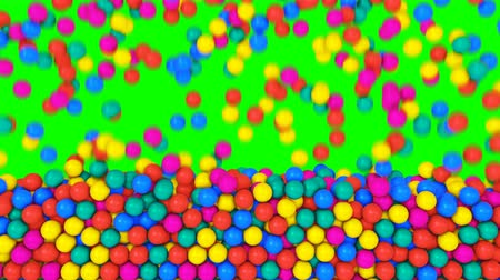 Pile of gumballs fill screen with colorful rolling and falling balls. Multicolored spheres in pool for children fun abstract transition. Bright 3D animation for composite overlay with green screen key