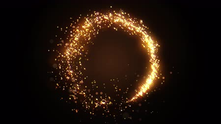 Golden glitter circle with sparkling light. Shining Christmas gold particles and sparkles ring on black background. Luxury magic festive effect with bokeh and glow. Dust trail 3d render in Ultra HD 4K Stockvideo