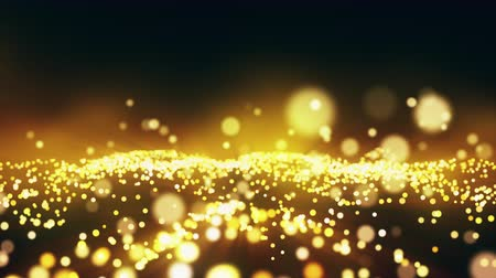 Abstract festive motion background with shining gold particles seamless loop. Christmas 3D animation of vibrant sparks wave movement with golden lights and bokeh. Bright holiday concept backdrop