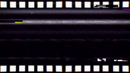 Vintage VHS negative film strip seamless loop. Old reel overlay with dirt, defects, noise, scratches, camera roll burns, grain and dust. Set TV tape glitch effect looping 3D render on black background Dostupné videozáznamy