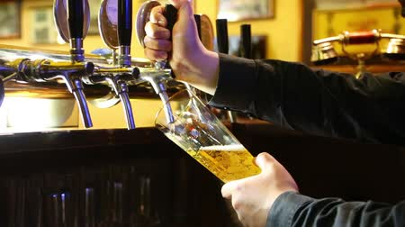 beer tap : Beer poured from the tap into a glass Carlsberg