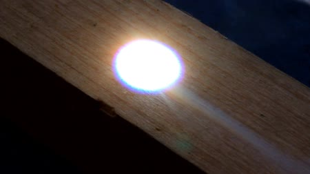 magnifying glass : Magnifying glass burns piece of wood. Stock Footage