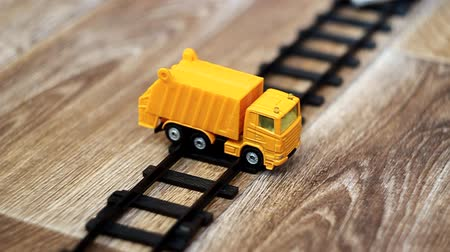 toy :   Black toy train and toy car wreck. Selective focus with shallow depth of field. Stock Footage