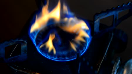 fogão : Natural gas in old and rusty portable stove burner, close up view. Selective focus.
