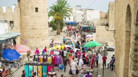 tunezja : The activity at the spontaneous market in Medina old town next to the fortress wall in Sousse, Tunisia.