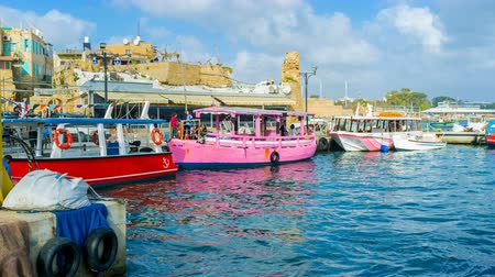 akko : The time-lapse of the busy harbor of Akko, with tourist boats that make a trip with tourists