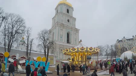 sofia : KIEV, UKRAINE - JANUARY 4, 2017: St Sophia Square is the main destination of Christmas festivity, here locates Christmas Tree, Market stalls, carousels and attractions for kids, on January 4 in Kiev.