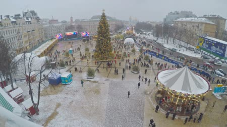 sofia : KIEV, UKRAINE - JANUARY 4, 2017: The bell tower of St Sophia Cathedral is the best viewpoint to enjoy Christmas festivity with main city Christmas Tree, Market stalls, carousels, on January 4 in Kiev.