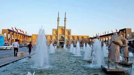 yazd : YAZD, IRAN - OCTOBER 17, 2017:  The sculptures of water carriers located in the fountain in Amir Chakhmaq square, Yazd