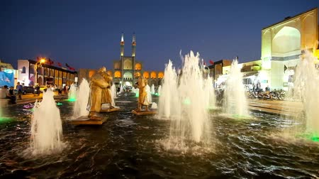 yazd : YAZD, IRAN - OCTOBER 17, 2017: Fountain in Amir Chakhmaq square with beautiful bronze sculptures attract tourists, on October 17 in Yazd