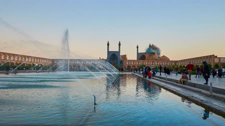 ispahan : ISFAHAN, IRAN - OCTOBER 19, 2017: Naqsh-e Jahan (Royal) Square is the favorite place for the walks and watch medieval landmarks - mosques, palaces and pavilions of bazaar, on October 19 in Isfahan.