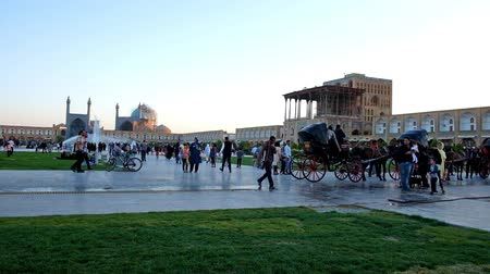 ispahan : ISFAHAN, IRAN - OCTOBER 19, 2017: The central square of the city, named Naqsh-e Jahan (Royal) is the famous tourist landmark and best place for family rest, on October 19 in Isfahan.