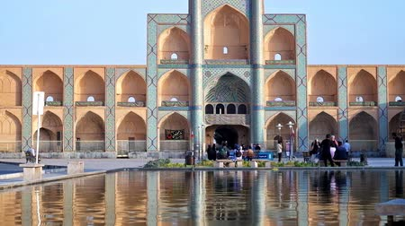 caravanserai : YAZD, IRAN - OCTOBER 18, 2017: Amir Chakmaq square is one of the most popular city landmarks, its scenic architectural complex contains mosque, caravanserai, tekyeh and hamam, on October 18 in Yazd. Stock Footage