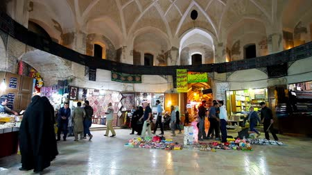 caravanserai : KERMAN, IRAN - OCTOBER 15, 2017: The Foursquare hall of Ganjali Khan Grand Bazaar with numerous stalls and many people, walking in covered market, on October 15 in Kerman.