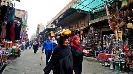 khalili : CAIRO, EGYPT - DECEMBER 20, 2017: The noisy street of Jawhar Al Qaed in Khan el Khalili old bazaar, located in Islamic Cairo district, on December 20 in Cairo.