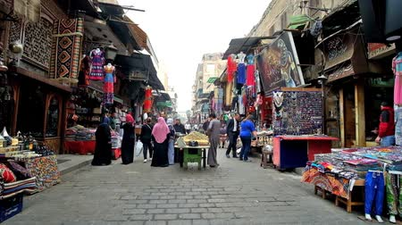 khalili : CAIRO, EGYPT - DECEMBER 20, 2017: Jawhar Al Qaed street of Khan el Khalili Bazaar in Islamic Cairo with numerous stalls and the young vendor, selling the lime from cart, on December 20 in Cairo.