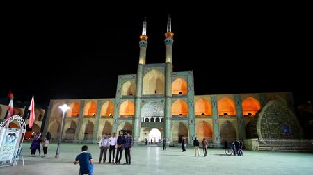caravanserai : Chakhmaq square with beautiful medieval architectural complex is famous city landmark, looking great in bright evening lights, on October 18 in Yazd. Stock Footage