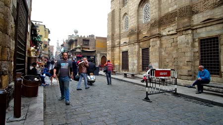 khalili : CAIRO, EGYPT - DECEMBER 20, 2017: Al-Muizz street is the heart of Islamic Cairo, here locate museums, palaces, religious complexes, Khan El Khalili bazaar, souvenir stores, on December 20 in Cairo. Stock Footage