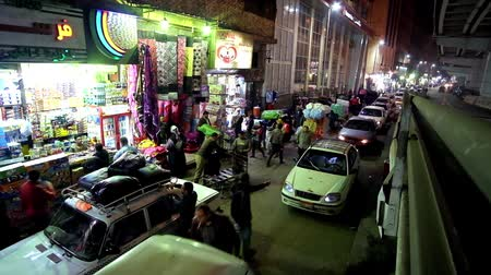 khalili : CAIRO, EGYPT - DECEMBER 20, 2017: The view from the overpass on the heavy traffic along Al-Azhar avenue and row of stores of crowded Khan El Khalili bazaar neighborhood, on December 20 in Cairo.