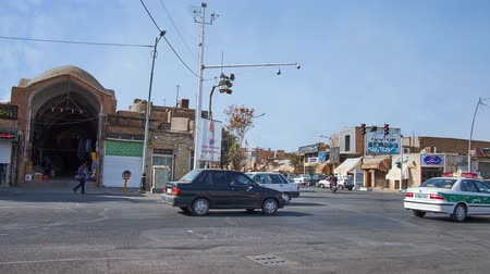 yazd : YAZD, IRAN, OCTOBER 18, 2017: The traffic along Imam Khomeini street with a view on the medieval portal of Khan Bazaar on background, on October 18 in Yazd.