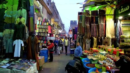 khalili : CAIRO, EGYPT - DECEMBER 20, 2017: The range of goods, local atmosphere and Eastern colorith attract people to visit Khan El Khalili Bazaar in Islamic Cairo district, on December 20 in Cairo.