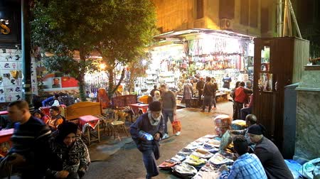 khalili : CAIRO, EGYPT - DECEMBER 20, 2017: The evening in Khan El Khalili Bazaar of Islamic Cairo district, people visit cafes, tourist stores, souvenir stalls and enjoy the atmosphere, on December 20 in Cairo