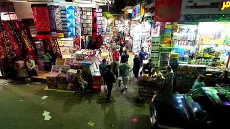 khalili : CAIRO, EGYPT - DECEMBER 22, 2017: Khan El Khalili bazaar is busy and crowded in the evening, locals visit it after the work and tourists enjoy the brightly illuminated shops, on December 22 in Cairo.