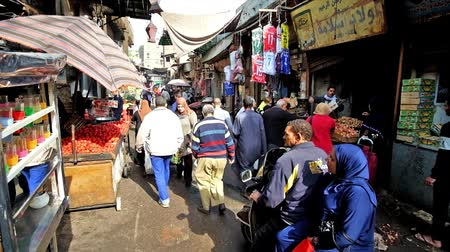 khalili : CAIRO, EGYPT - DECEMBER 21, 2017: The crowded food department of Khan El Khalili bazaar, the narrow alley with stalls, full of fruits, vegetables, fish and other products, on December 21 in Cairo.