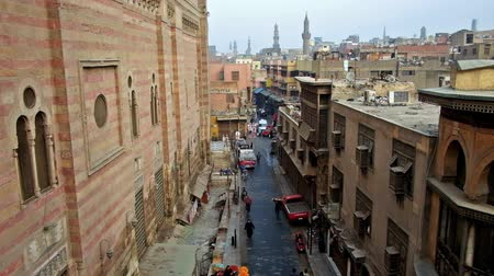 khalili : CAIRO, EGYPT - DECEMBER 21, 2017: Bab Zuwayla gate is nice viewpoint to overlook Sultan al-Muayyad mosque, Al Muizz street with historic mansions and market stalls, on December 21 in Cairo, Egypt.